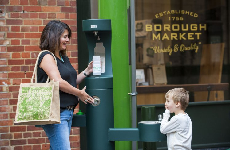 woman and child using water refill station also known as community refill hub outside of Borough Market