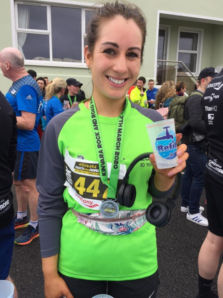 brunette lady drinking water after 10k race from a reusable Refill.ie cup